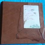 album di pelle con foto decorato a mano
